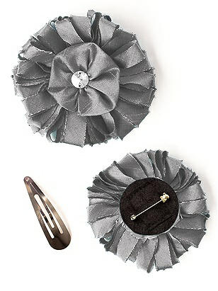 Dupioni Confetti Flower with Rhinestone Detail http://www.dessy.com/accessories/dupioni-confetti-flower-with-rhinestone-detail/
